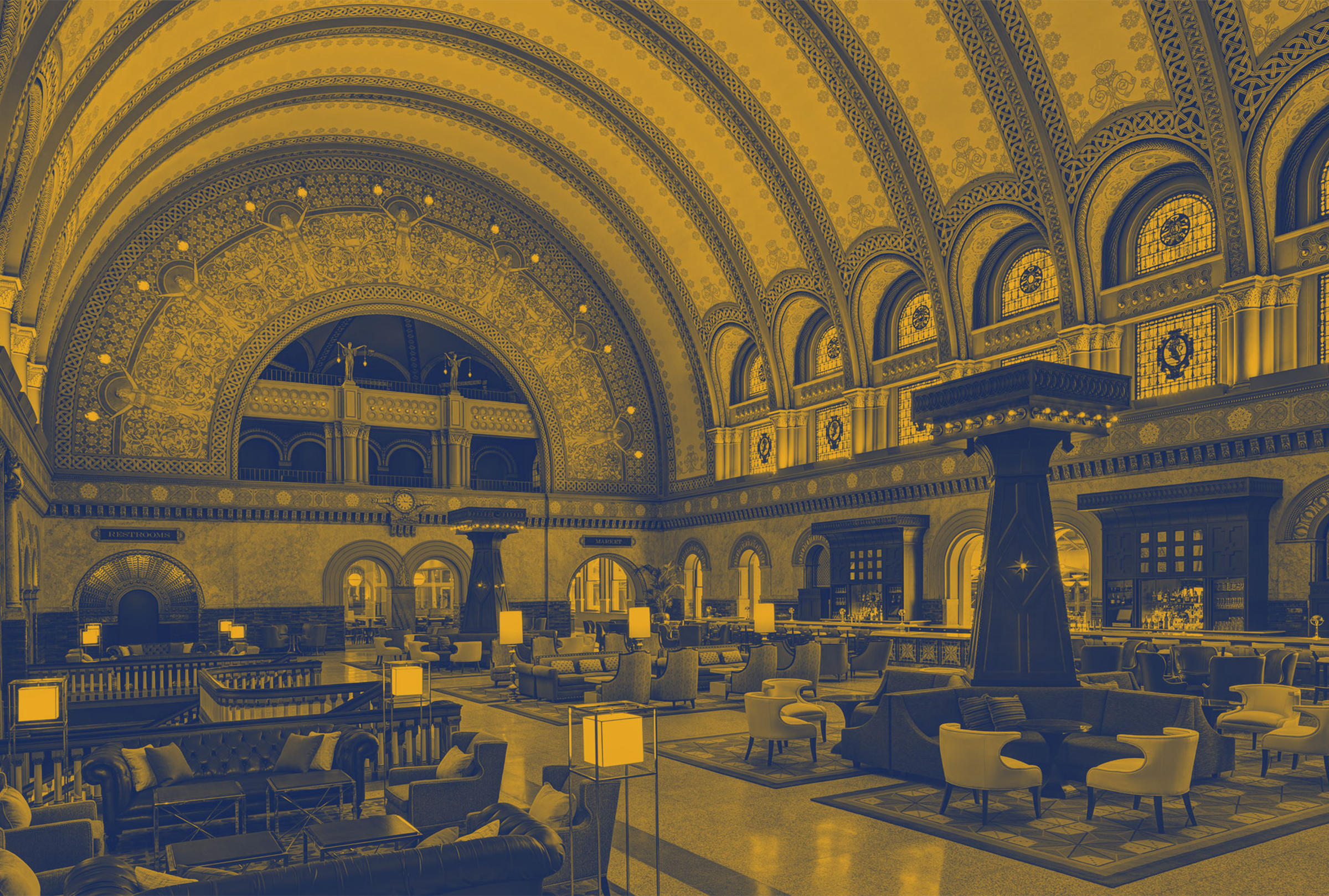 Yellow duotone image of the Grand Hall at Union Station'